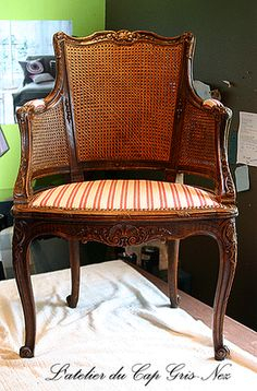 Gorgeous carved and caned chair.