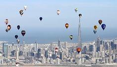 Dubai, United Arab Emirates: Hot air balloons fly over Dubai during the World Air Games
