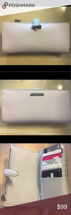 Rebecca Minkoff Sage Wallet Stunning wallet!!! I purchased and used maybe for two weeks. I am a extra large wallet girl so this doesn't work great for me!!! It is a medium-large size wallet. The pictures don't do it justice! It's light gray and light pink. Has TONS of pockets!!! Super cute! Last picture shoes true color Rebecca Minkoff Bags Wallets