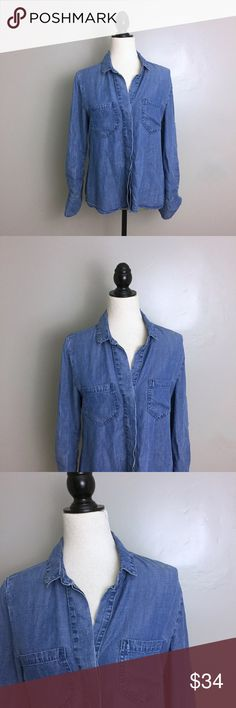 """Anthropologie Bella Dahl Chambray Button Down Top Bella Dahl. Size S. Chambray Denim. Collared. Front chest pockets. Hidden buttons. Hi Low Hem. Adjustable length sleeves. Tuxedo split back. Shown on size Medium dress form. All measurements are flat and unstretched; Pit to Pit- 18"""" Shoulder to Hem- 24"""". Preowned. Anthropologie Tops Button Down Shirts"""