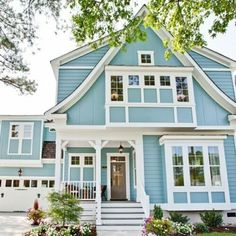 Love this color blue with the white trim - would go well with our used brick trim.