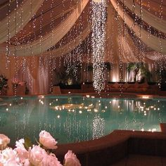 A nice idea to make an indoor pool more glamorous. Decoration with lights, flowers, and