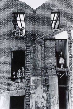 Children in bombed building  Bermondsey London 1954
