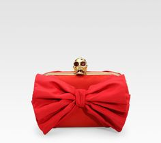 The Alexander McQueen skull bow clutch carried to the Jubilee River Pageant
