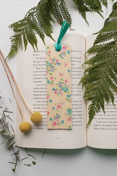 Keep track of your place in a favourite book, journal or magazine with this unique handmade wood floral bookmark. You will no longer need to reach for an old receipt or scrap of paper to mark your place…and no more folding the corners of pages! Each bookmark is handmade in Australia using lightweight, flexible wood, gorgeous photo image transfer and finished with coloured ribbon. #stitchandwood #bookmark #floral # giftidea Flexible Wood, Wood Transfer, Ribbon Colors, Book Journal, Book Lovers, Are You The One, Bookmarks, Mall, Great Gifts