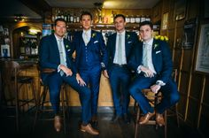 Groom and grooms men in blue.  A stop by the pub before Bec and Chris' pretty, rustic barn wedding with accents of peach and mint.   www.babbphoto.com