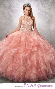 Princess style 4Q483 • Organza quinceanera ball gown with beaded bodice, illusion scoop neck line, illusion back with keyhole and lace-up closure, beaded basque waist line, and ruffle skirt.