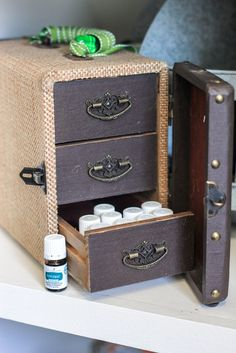How to store essential oils- love this burlap train case with drawers!  So cute!