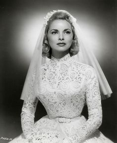 "Janet Leigh actress of ""Pyscho"" in a high neck long sleeve lace wedding dress - 1950's"