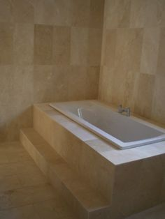 Light Coloured Marble Tiles Fitted In Bathroom, Including Around Bathtub