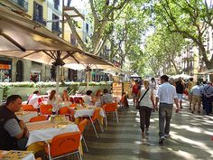 Las Ramblas in Barcelona... Flower stands, cafes, artists, so pretty to take a stroll down