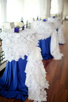 Cocktail tables; not CE's original idea, but such a cool way to use linens!