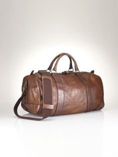 Travel in style with the ultimate accessory for the gentleman, our Polo Ralph Lauren Leather Duffel Bag