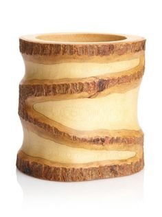 Enrico Mango Wood Utensil Vase with Bark Accent, Natural by Enrico. $24.95. Gorgeous wood grain and unique natural bark edge. Hand-carved. Natural lacquer finish. Made from environmentally-friendly reclaimed mango wood. Food safe finish can be hand washed and cleans up easily. Enrico #2810 Mango Utensil Vase with Bark Accents is a perfect addition to your kitchen collection and keeps all your utensils in one convenient place while looking terrific.  Coordinates well with an arra...