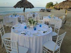 Tables set up on the beach during a wedding reception at romantic Jamaica Inn, Ocho Rios http://jamaicainn.com/romance/weddings.php