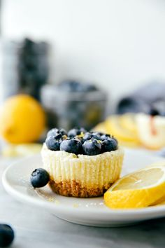 Miniature sized cheesecakes flavored with a hint of lemon, topped with blueberry jam, and covered with lots of fresh blueberries. A sprinkle of powdered sugar gives these cheesecakes the perfect finishing touch.