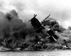 World War II: Pearl Harbor. The battleship USS Arizona belches smoke as it topples over into the sea during a Japanese surprise attack on Pearl Harbor, Hawaii Uss Arizona, Pearl Harbor Day, Pearl Harbor Attack, Pearl Harbor 1941, Us History, American History, Naval History, History Channel, Ancient History