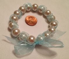 Stretch bracelet with 12mm glass pearl and ribbon bracelet $15