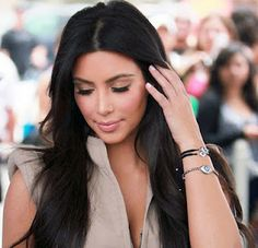 we love how kim k. stacks up her evil eye wrist (maybe they will help her ward off evil basketball players)!