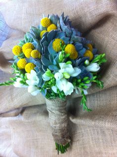 Succulents, sunflowers, billy balls, and freesia bride bouquet.