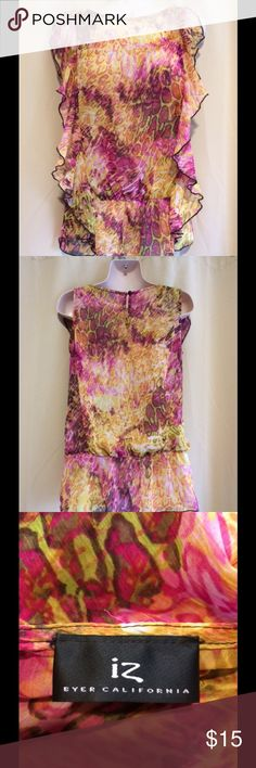 Beautiful multi colored blouse Pink, yellow, brown and slight hints of light green make up this great versatile top. Great for travel as it doesn't wrinkle. Keyhole buttons up at back of neck. IZ Tops Blouses