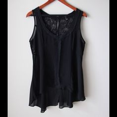 "Forever 21 sheer top Black sheer top with lace accents - sleeveless style - back lace with button closure - high low hemline - chest across measures 19.5"" - total front length measures 25"" - total back length measures 30"" - size L Forever 21 Tops"
