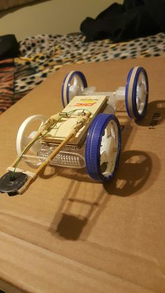 how to make a mousetrap car that goes 10 meters