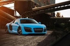 Bright Blue Audi R8 with Black Rims and sidebalde