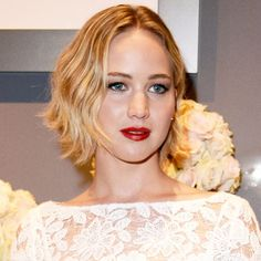 Just when we thought Jennifer Lawrence couldn't get any cooler, she proved uswrong. Promoting her new filmPassengers at the Sony Pictures CinemaCon in Las Vegas, the 25-year-old actress debuted an icier rendition of her already platinum blonde hair and the result is breathtaking. Pulled back into a half-do, her wavy lob looks borderline gray, in the best way possible.