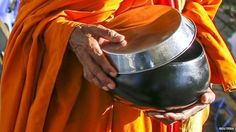 Thai Buddhist monk, carrying traditional bowl