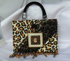 Hey, I found this really awesome Etsy listing at https://www.etsy.com/listing/79210210/leopard-purse-vintage-compact-cigarette