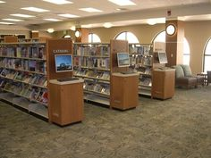 Steel library shelving with custom end panel OPAC stations. ==Library Interior Designs== library furniture distributors,library furniture,school library furniture,library bookcase design,library inter...