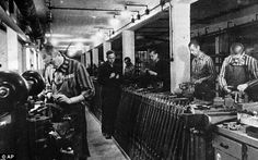 Slave labour: Jewish slave workers in striped uniforms work in a Nazi ammunition factory near Dachau concentration camp during World War II. WirtschaftsWoche has published a league table illustrating the Nazi past of top German firms like Bosch, Mercedes, Deutsche Bank, VW and many others, which involved the use of almost 300,000 slaves