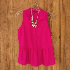 American Eagle sleeveless peplum blouse EUC Darling! Bright fuchsia 100% poly with a silky look and feel, great for travel. Hidden snaps on front. Paired with jeans for casual, or wear to work! This is a must have for spring/summer. American Eagle Outfitters Tops Blouses