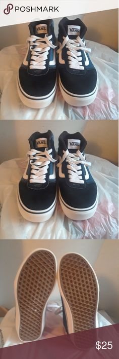 Vans Canvas Shoe's Men's Size 7 This is a used pair of Vans Canvas Shoe's Men's Size 7, they are black, blue and white canvas high top Shoe's, there are no holes or tears on either shoe. Please view the pictures and if you have any questions please ask. Van Shoes Sneakers