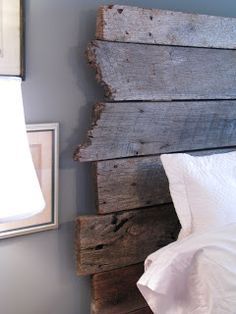 Making a headboard. Take some old barnwood, nail it to two 2x4s.  If a board is too long, just break it off.  Love the jagged uneven look.
