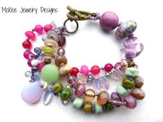 Purples, pinks. Ceramic, lampwork, Czech glass, metal and cording Knotted Multi strand bracelet. McKee Jewelry Designs