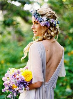 Boho Bride's purple flower crown with long braid wedding hair