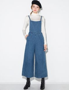 Cute Denim apron overalls with wide leg and button suspenders. Back zip closure. *Cotton blend*Model is wearing a size small and model's height is 5.8