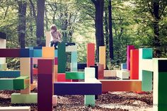 Very cool color block playscape!! And in the middle of the woods? Very unique.