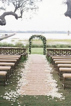 Classic Floral Arch with Petal Burlap Wedding Aisle Runner  and Linen Upholstered Wooden Benches