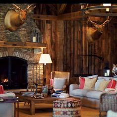 Hunting room: stone fireplace w simple mantle and mount