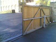 Sliding gate for back garden. Much easier than swing gates to keep clear.