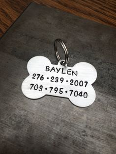 Click here to personalize your own pet ID tag: https://www.etsy.com/listing/179863283/dogbone-aluminum-id-tag-large-pet-tag?ref=shop_home_active_16   $10