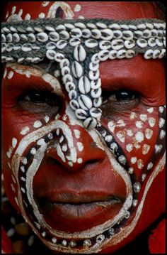 Papua New Guinea Tribal face paint. I like how a range of materials are used (not just paint) and the bold striking colours.