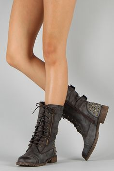 Be bold and unique in these vintage-inspired military boots! Featuring round toe, buckles and studded spike details at the back, zipper trim on the side, lace up closure, and low flat heel. Finished with cushioned insoleand side zipper closure for easy on/off.