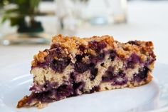 Blueberry buckle recipe, an old-fashioned single layered cake, peppered with blueberries, and topped with a streusel topping.
