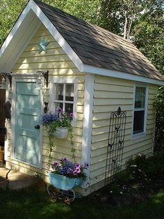 I really like this color yellow. Our shed looks nothing like this one, but I think the color would go well with the color of our house.
