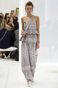 """To create buzz, the brand put together a prefab """"Tod's Band"""", fronted by its runway models Camilla and Guilia Venturini and Mae Lapres, among others. These girls may not actually play any music, but their looks—like a perforated gray leather cami and maxi skirt or off-shoulder white top and black perf skirt—could offer an interesting off-stage wardrobe for the real deals.    - HarpersBAZAAR.com"""