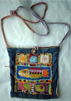 I bought a needlepoint hoop, bag of embroidery thread, needles and needlepoint fabric. I loosly sketched a design on the fabric and just randomly started sewing. Patchwork Bags, Quilted Bag, Art Bag, Handmade Purses, Boho Bags, Denim Bag, Fabric Bags, Textile Art, Purses And Handbags